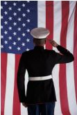 Soldier in Dress Uniform Soluting American Flag