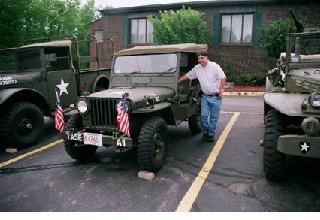 Man Standing with Antique Army Jeep