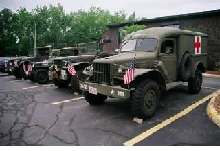 Antique Army Jeeps in Parking Lot