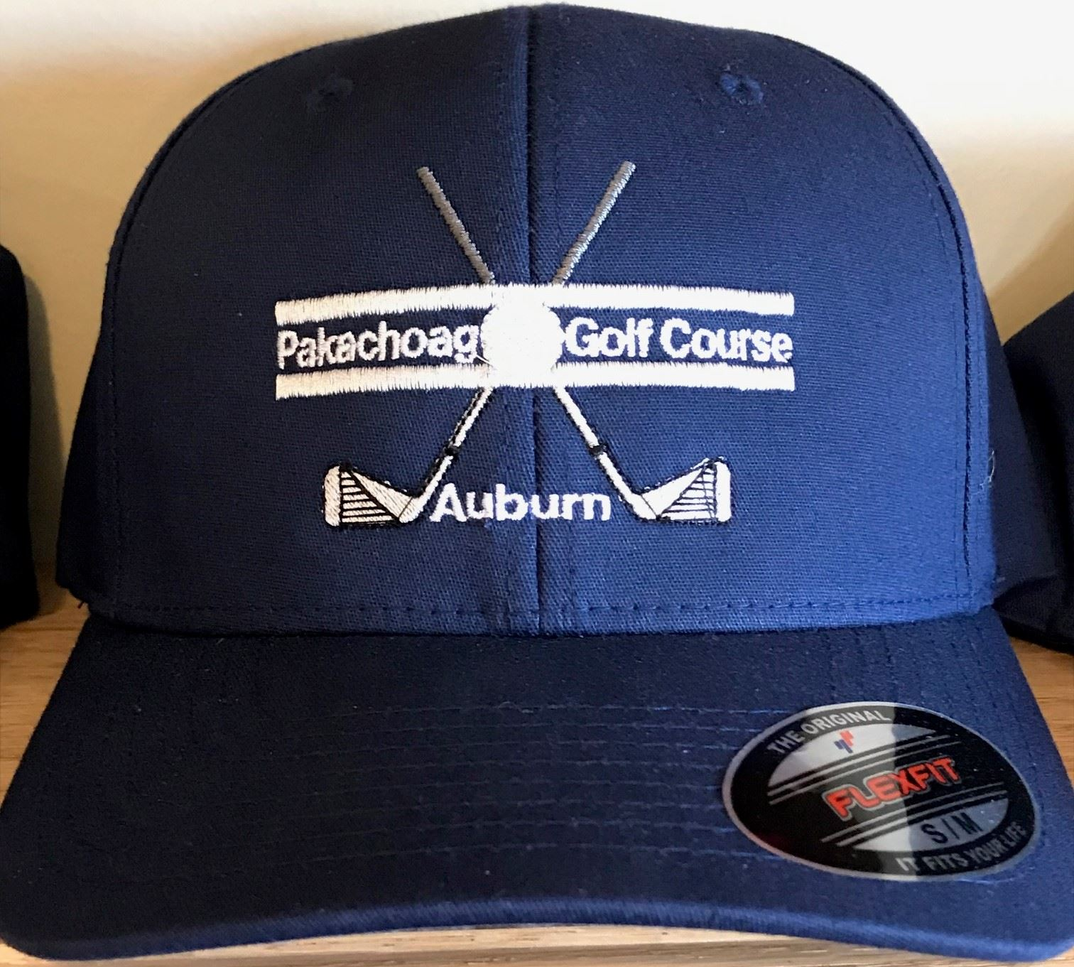 Fitted hat with golf course logo