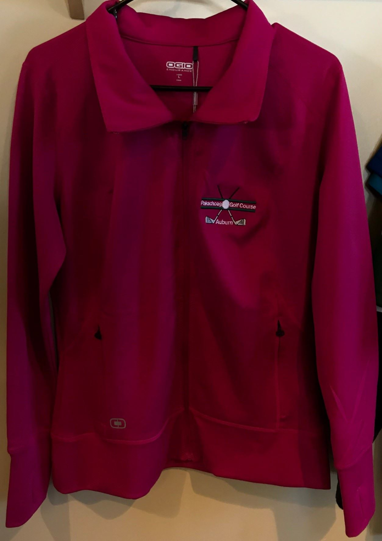 Long sleeve women's zip up jacket with golf course logo