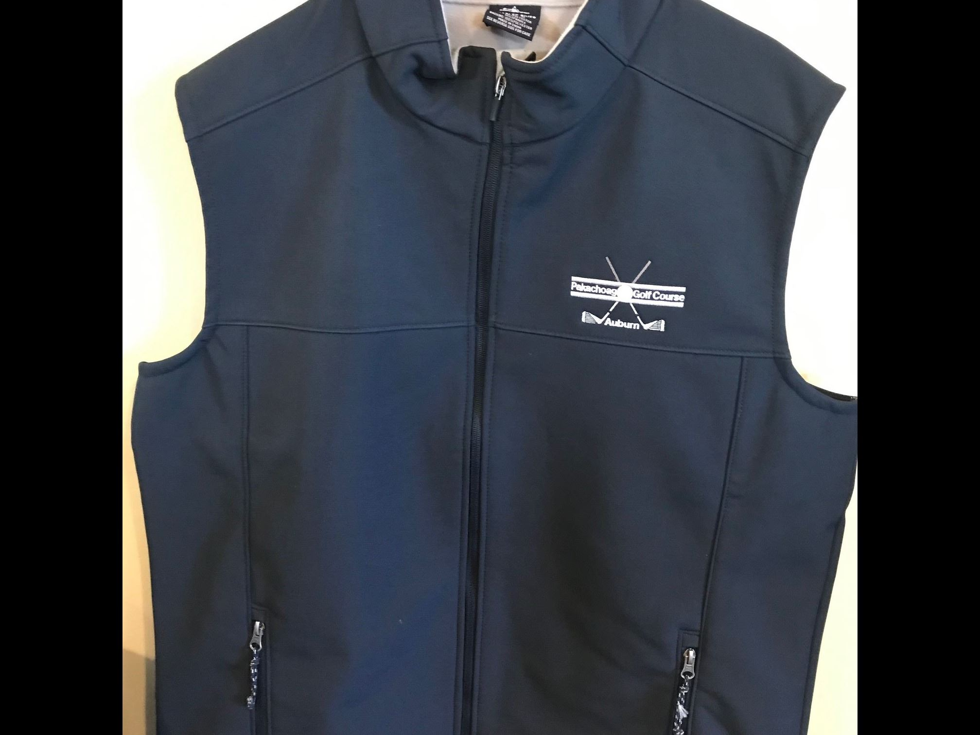 Vest with golf course logo